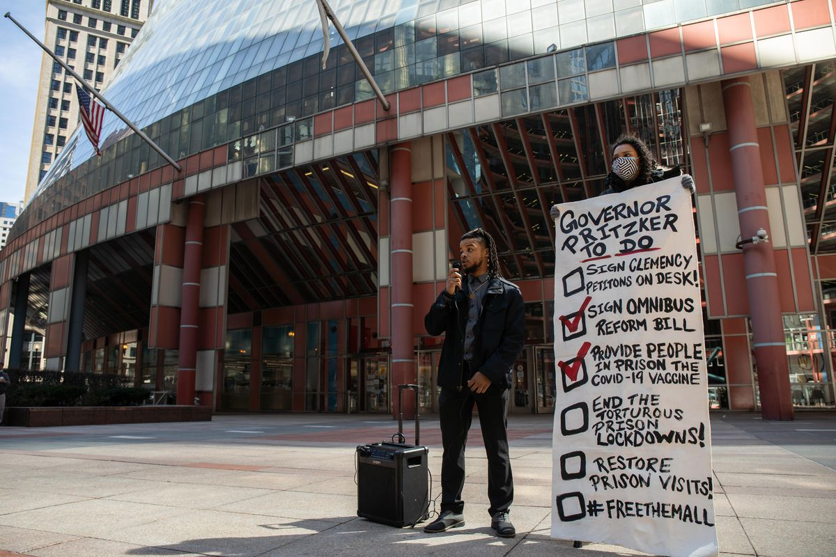 Malik Alim, a campaign coordinator at for the Coalition to End Money Bond, speaks outside the James R. Thompson Center in the Loop, Friday morning, March 9, 2021.