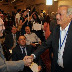 The Russian Ambassador in Damascus, Azmat Allah Kolmahmedov, left, greets Aref Dalila, a Syrian opposition figure at the opening session of a conference of some 16 opposition parties headed by the National Coordination Body for Democratic Change in Syria, an opposition group made up mostly of Syria-based opposition personalities, in Damascus, Syria, September 23, 2012. The rare opposition gathering in a regime-held city, which called for the overthrow of the Syrian regime, was attended by the Ambassadors from China and Russia, both countries that support Assad, suggesting the regime authorized the conference to bolster its own rhetoric that there should be a peaceful settlement to the Syrian crisis through dialog.