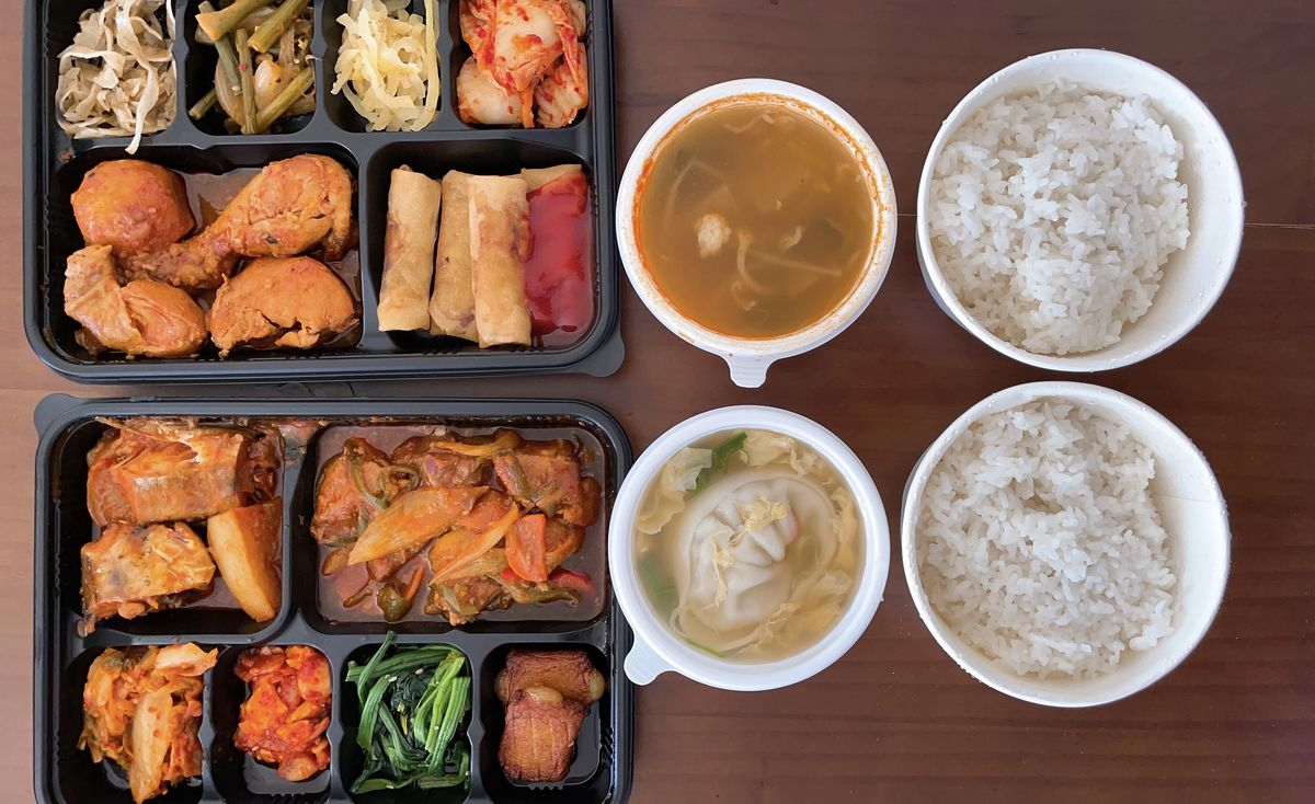 Two containers of food with bowls of rice and soup.