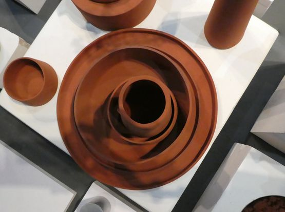 Overhead shot of rust colored pottery