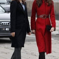 To visit a UNICEF facility in Denmark on November 2nd, 2011, the Duchess wears a red L.K. Bennett coat.