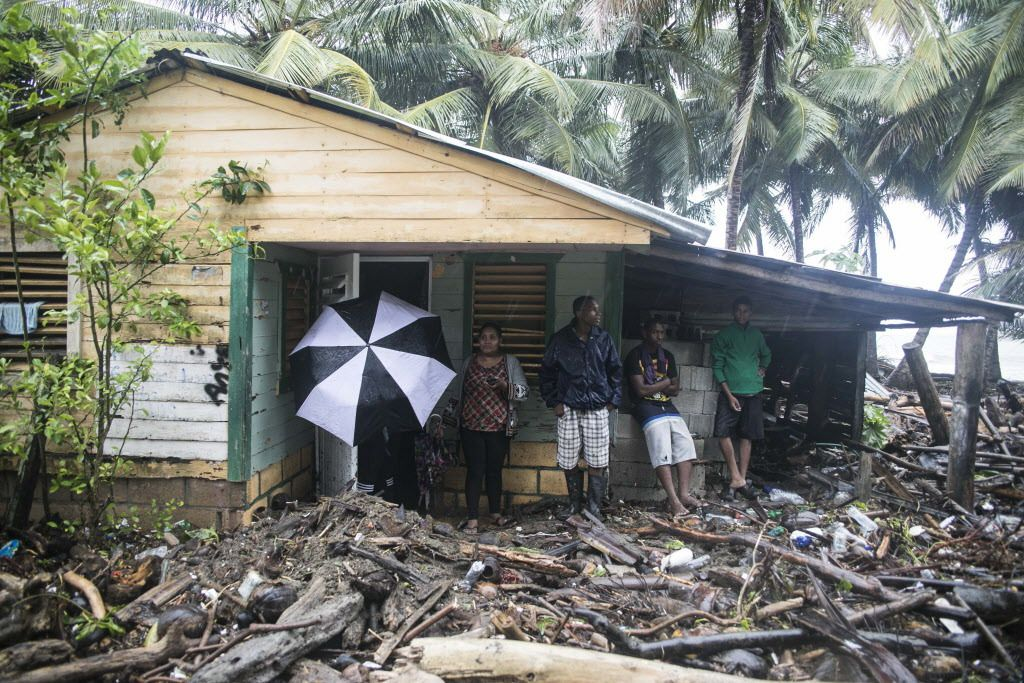 A home is surrounded by debris brought in by Hurricane Irma in Nagua, Dominican Republic, Thursday, Sept. 7, 2017. Irma flooded parts of the Dominican Republic when it roared by Thursday, just off the northern coast of the island it shares with Haiti.   T