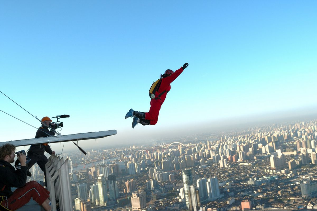 This BASE jumper is in Shanghai but nonetheless symbolizes the nonstop excitement of Americans' lives.