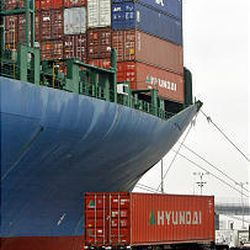 A truck departs after picking up a container in the congested Long Beach port. Ships can wait as long as five to nine days before they can be unloaded.