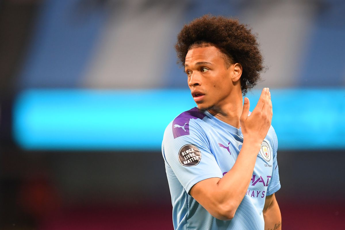 Leroy Sane of Manchester City looks on while showing the Black Lives Matter movement logo on his shirt sleeve during the Premier League match between Manchester City and Burnley FC at Etihad Stadium on June 22, 2020 in Manchester, England.