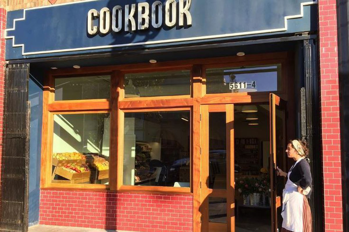 Cookbook Market in Highland Park exterior with woman standing at the door.