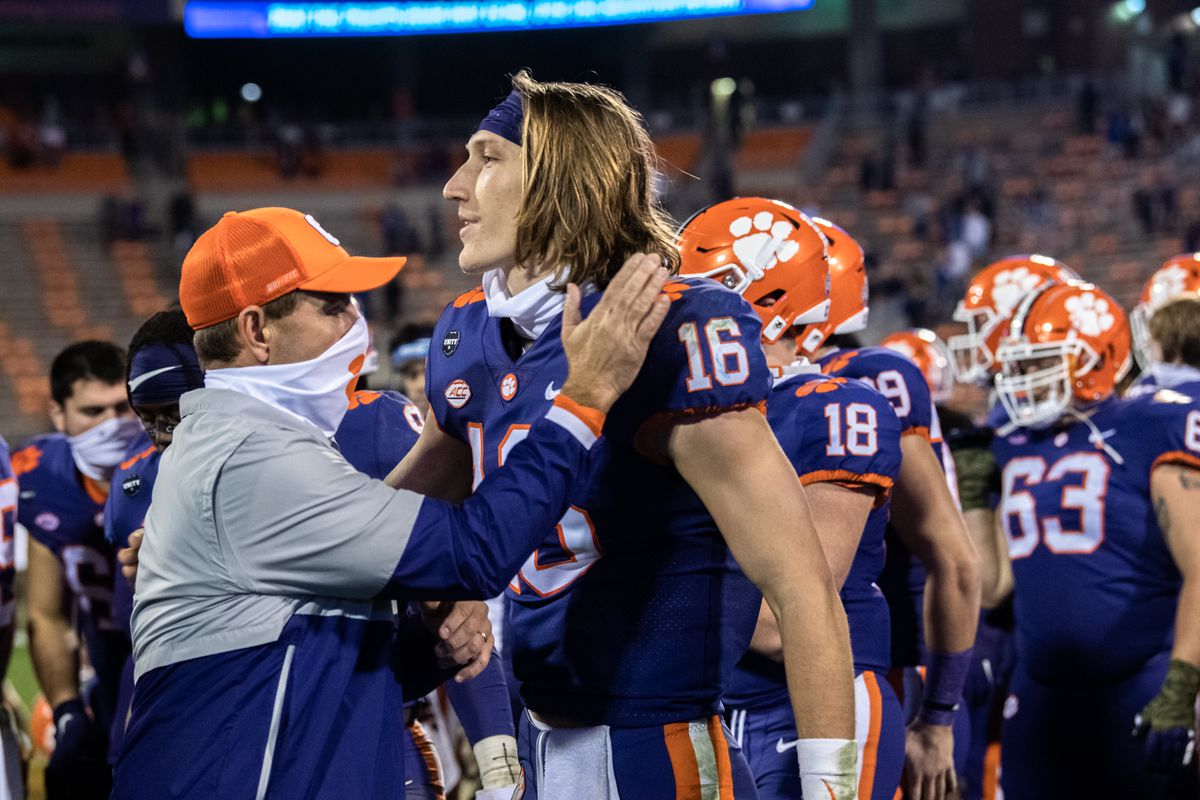 Clemson head coach Dabo Swinney pats Clemson quarterback Trevor Lawrence on the shoulder following their 52-17 win over Pittsburgh at Memorial Stadium.