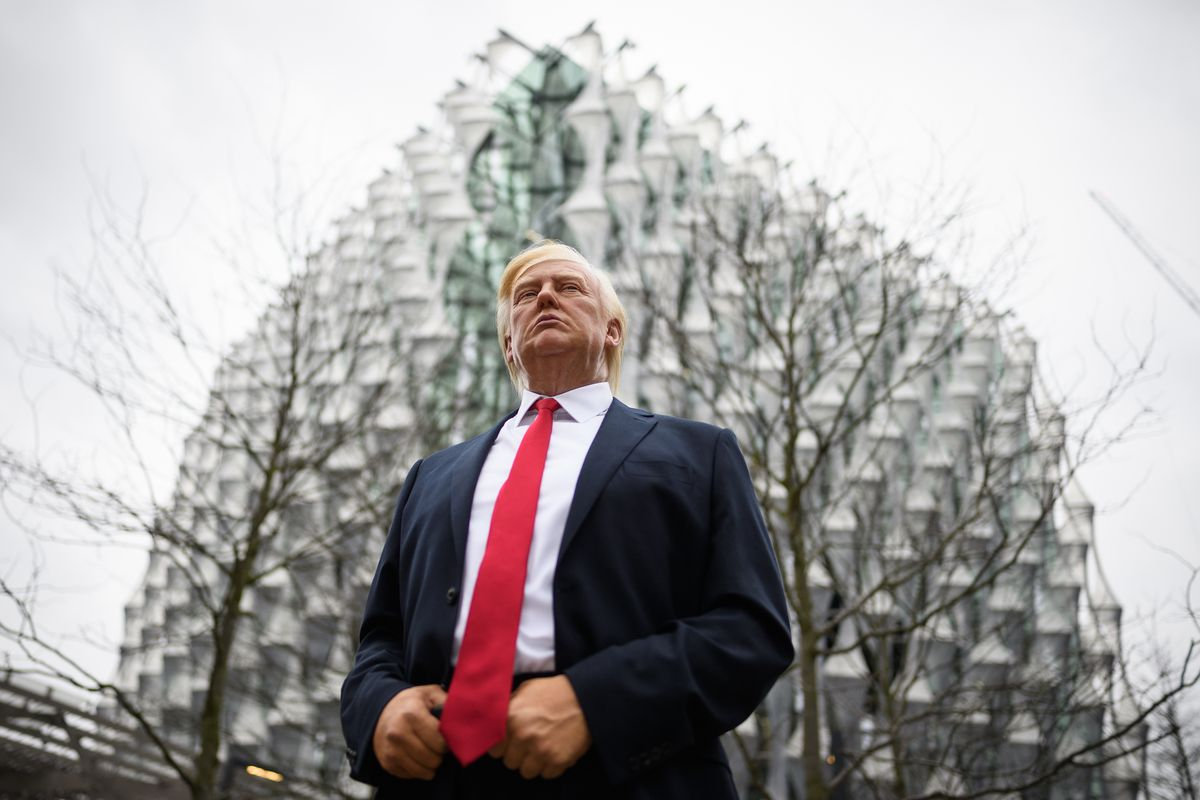 A wax model of President Donald Trump outside the new US embassy in the United Kingdom.