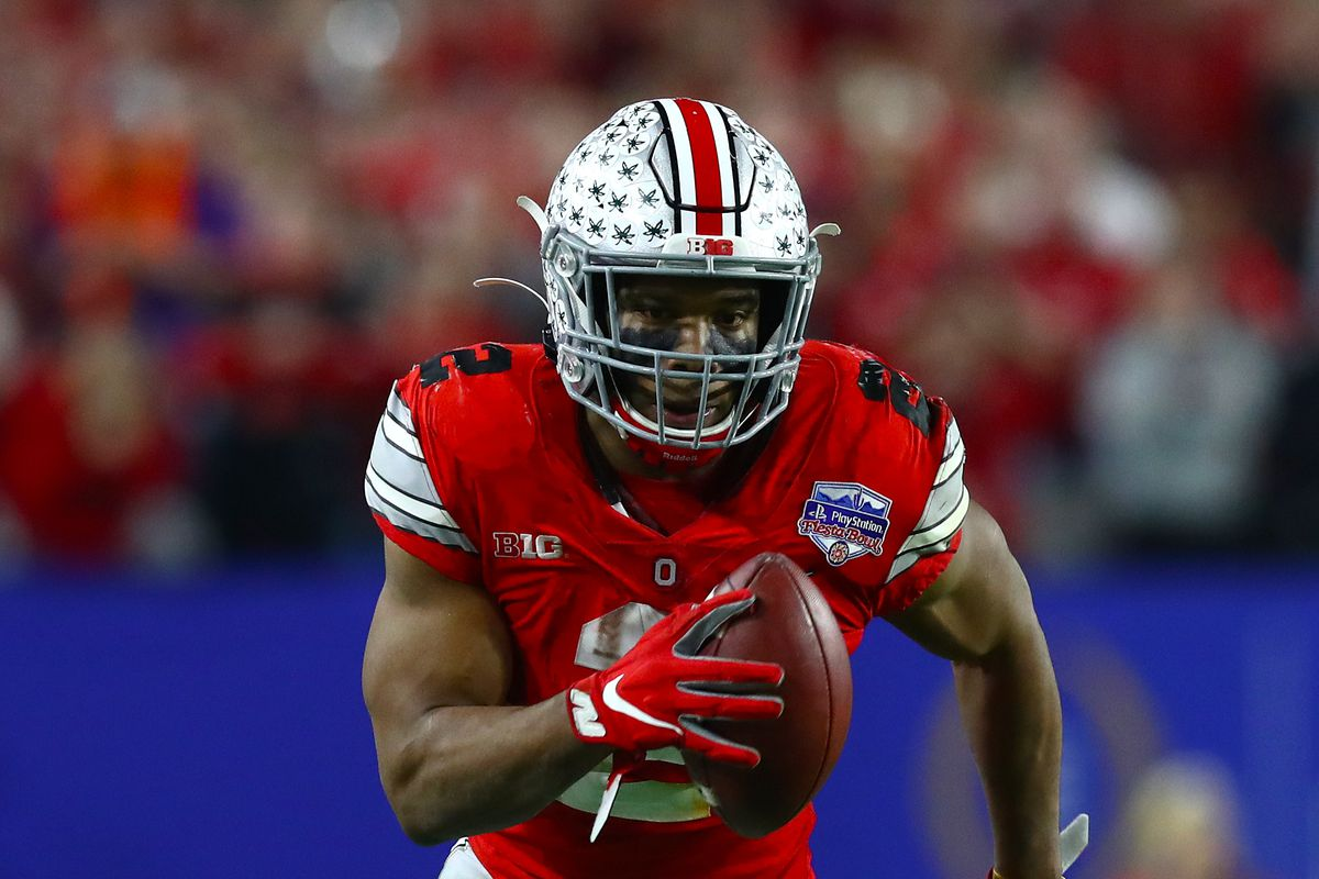 Ohio State Buckeyes running back J.K. Dobbins runs with the ball against the Clemson Tigers in the 2019 Fiesta Bowl college football playoff semifinal game.