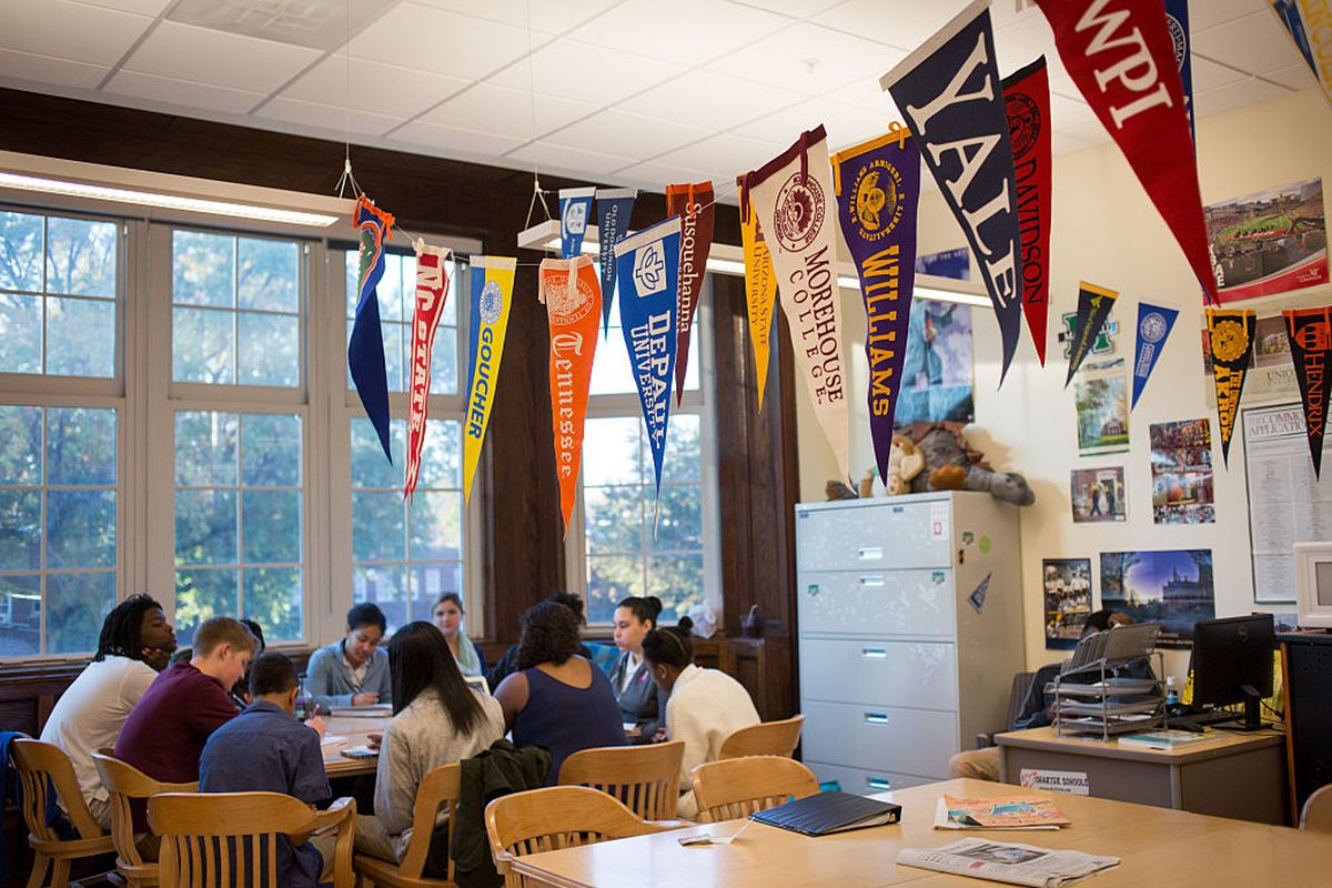 College banners hang in the classroom of teacher Chrys Latham, as she leads a senior advisory period, at Washington Latin Public Charter School.