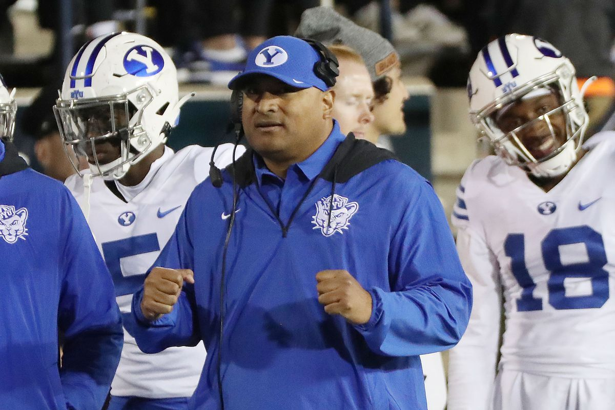 Brigham Young Cougars coach Kalani Sitake celebrates a field goal in a game against the Utah State Aggies.