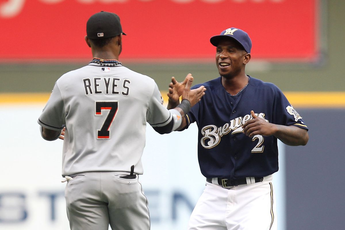 MILWAUKEE, WI - JULY 02: Nyjer Morgan #2 of the Milwaukee Brewers shakes hands with Jose Reyes #7 of the Miami Marlins before the start of the game at Miller Park on July 02, 2012 in Milwaukee, Wisconsin. (Photo by Mike McGinnis/Getty Images)