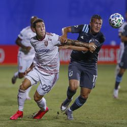 Real Salt Lake defender Aaron Herrera (22) and Minnesota United midfielder Robin Lod (17) battle for the ball during the first half of a soccer match in Kissimmee, Fla., Friday, July 17, 2020.