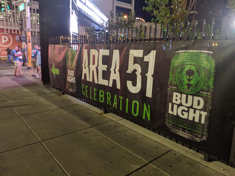 A photo of a sign offering Bud Light's Area 51 beer.