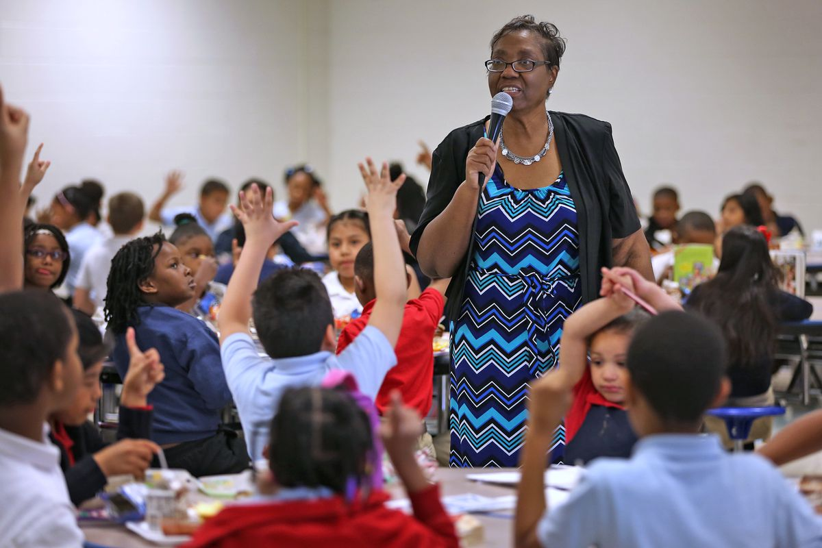 Principal Joyce Akridge tries to squeeze in learning at every moment, like at lunchtime, at IPS School 79.