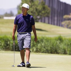 CJ Lee smiles after a put at the No. 8 hole on the third day of the 78th Provo Open at East Bay Golf Course in Provo Saturday, June 10, 2017.