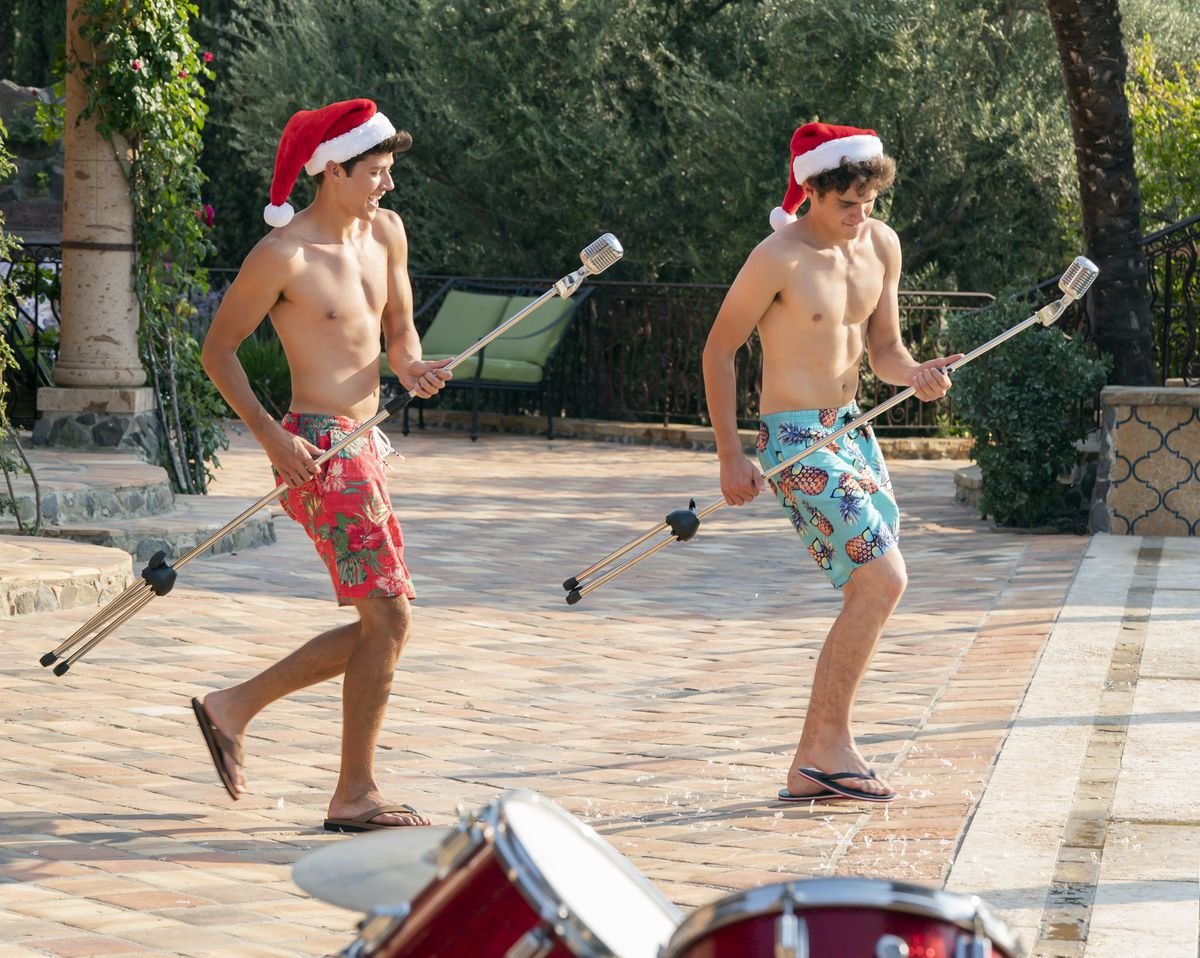 ricky and EJ in swim trunks and santa hats