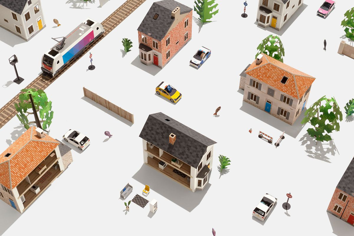 Paper buildings arranged into a neighborhood. A paper path with a train car runs nearby.