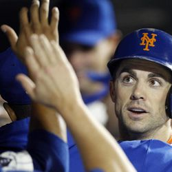 Teammates and coaches greet New York Mets David Wright in the dugout after Wright passed former Met Ed Kranepool to become the team's all-time hits leader during their baseball game against the Pittsburgh Pirates at Citi Field in New York , Wednesday, Sept. 26, 2012. Wright collected his 1419th hit in the third inning of the game.