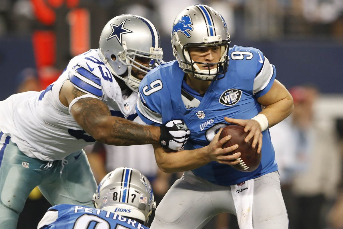 Anthony Spencer about to separate Matthew Stafford and the football.