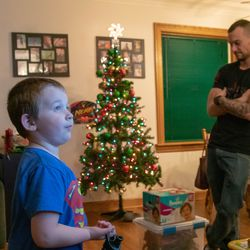 Liam Miller (L) and his father, Lorin Miller (R) in their Oriole Park home.   Brian Ernst/Sun-Times