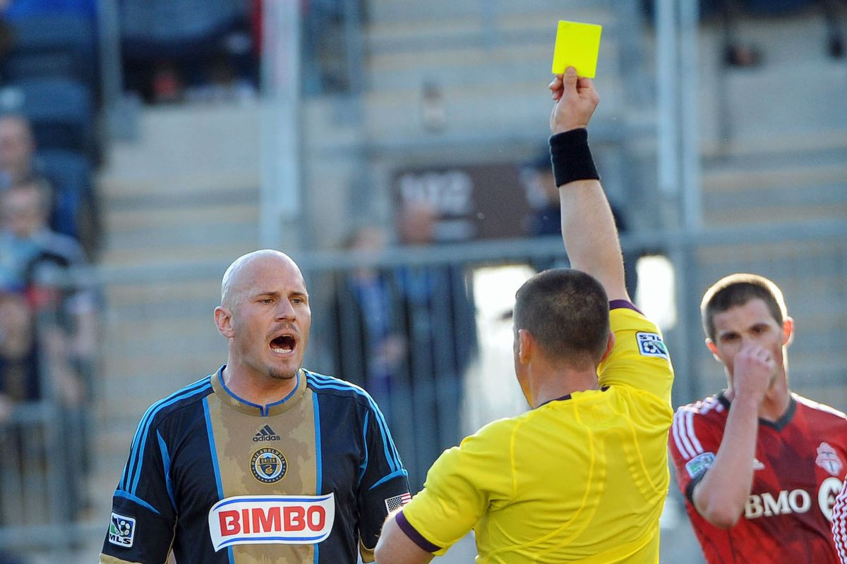 Referee Sorin Stoica adds the final piece to his house of cards.