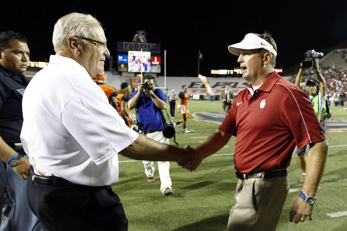 September 1, 2012; Dallas, TX, USA; Oklahoma Sooners head coach Bob Stoops (right) and UTEP Miners head coach Mike Price greet each other after the football game at Sun Bowl Stadium. Oklahoma won 24-7. Mandatory Credit: Jim Cowsert-US PRESSWIRE