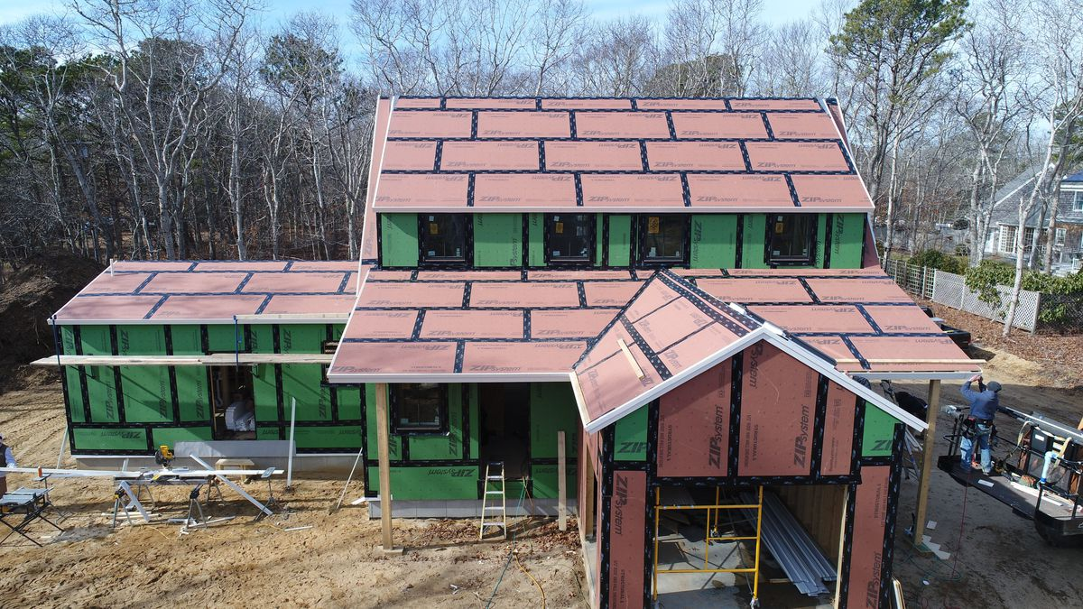 Workers complete installation of fascia boards at the TOH 2020 Idea House on the Cape