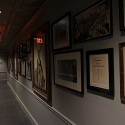 Artifacts line the hall to the bathrooms.