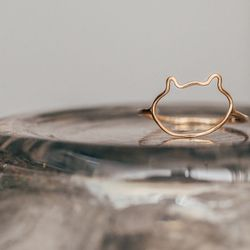 """Bittersweets NY Kitty Ring, <a href=""""http://shop.thistleclover.com/collections/bittersweets/products/bittersweets-kitty-ring"""">$150</a>"""