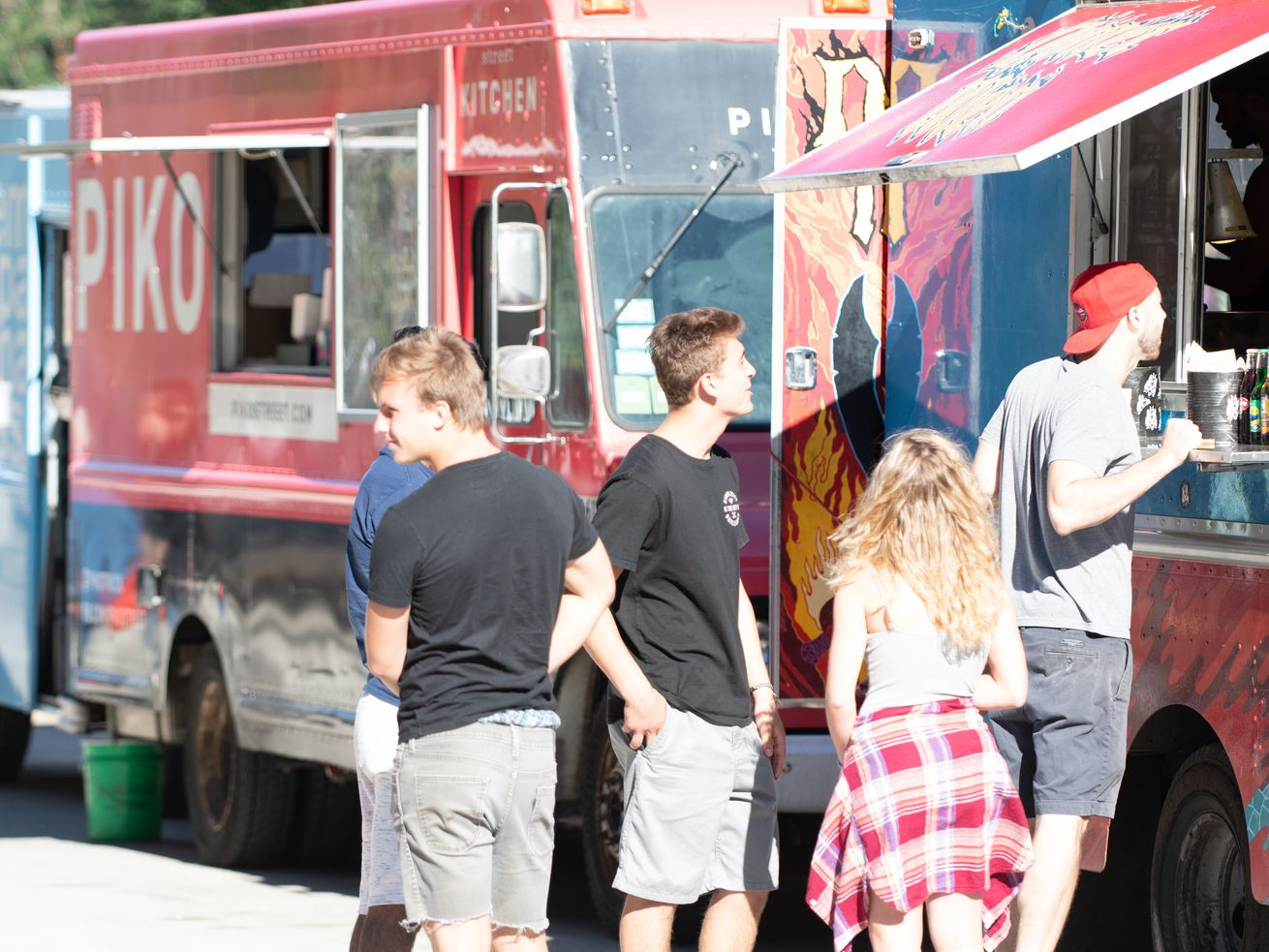 People in line for food at a food truck at West Fest in the West Town neighborhood of Chicago, IL on July 6, 2018.