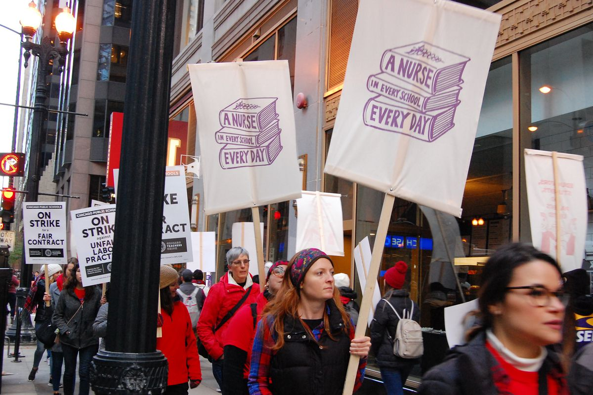 School nurses and their supporters picketed in downtown Chicago on the first day of the teachers strike, Oct. 17, 2019.