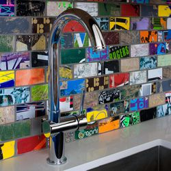 """This undated publicity image provided by Art of Board shows a sink backsplash made with """"skate tile,"""" and hand cut from recycled skate decks in Los Angeles."""
