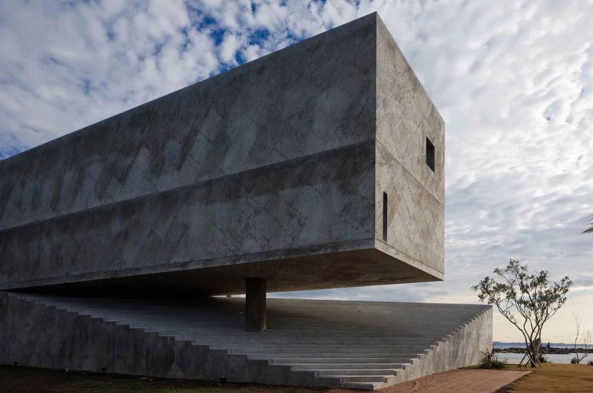 Concrete house balancing over base