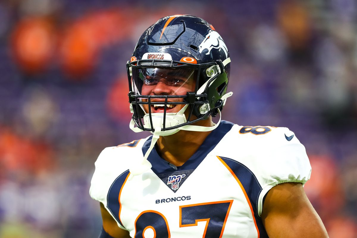 Denver Broncos tight end Noah Fant looks on before the start of a game against the Minnesota Vikings at U.S. Bank Stadium.