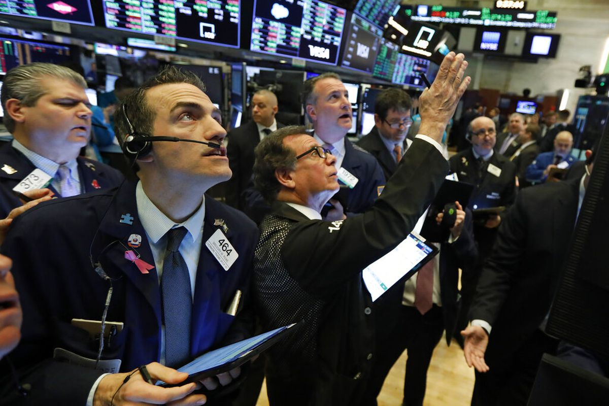 Traders gather at a post on the floor of the New York Stock Exchange, Wednesday, March 4, 2020.