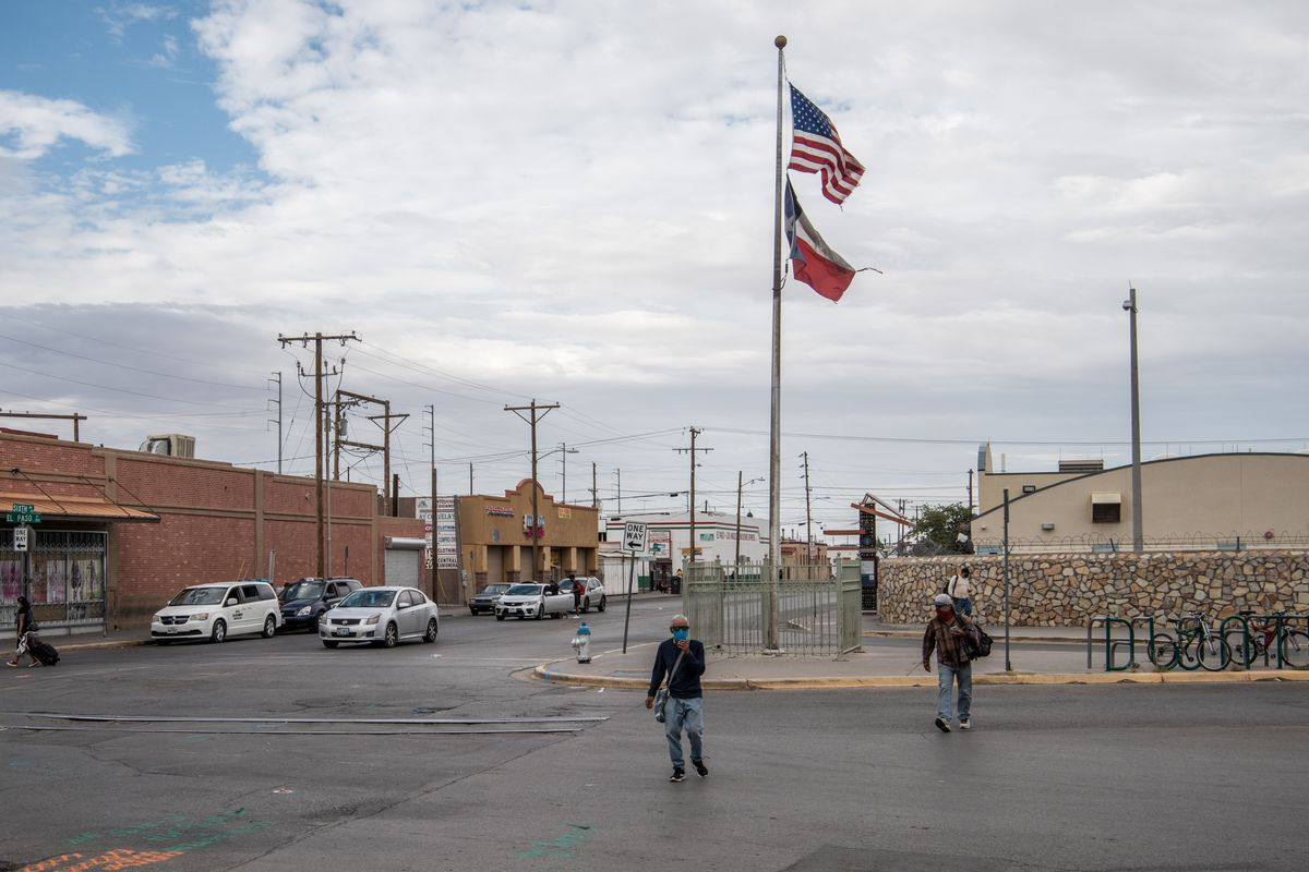 People walk through the street near downtown on July 1, 2020 in El Paso, Texas.