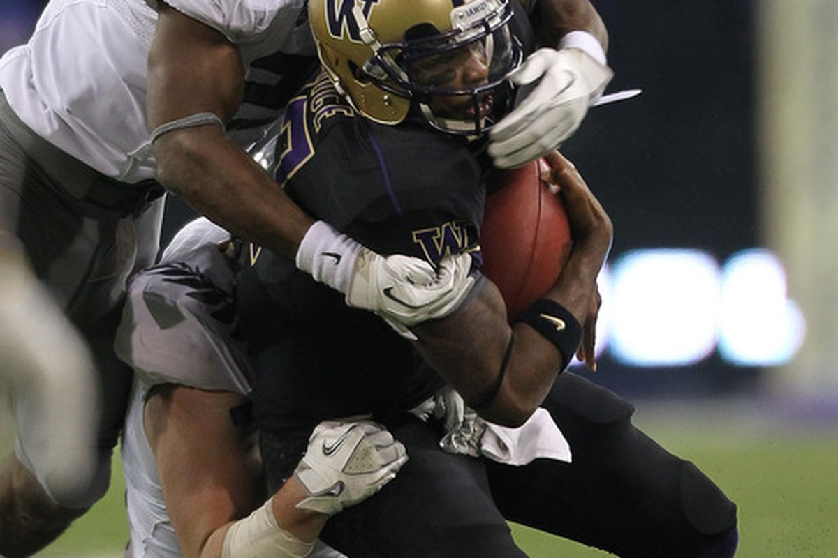 SEATTLE - NOVEMBER 05:  Quarterback Keith Price #17 of the Washington Huskies is sacked by Taylor Hart #66 of the Oregon Ducks on November 5, 2011 at Husky Stadium in Seattle, Washington. (Photo by Otto Greule Jr/Getty Images)