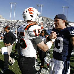 Brigham Young Cougars quarterback Riley Nelson, right, shakes hands with Idaho State Bengals quarterback Kevin Yost after Brigham Young University defeated Idaho State in NCAA football in Provo, Saturday, Oct. 22, 2011.