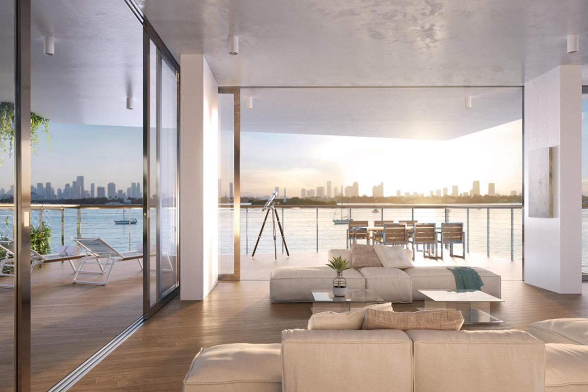The Miami skyline beyond a gorgeous corner waterfront residence at Monad Terrace