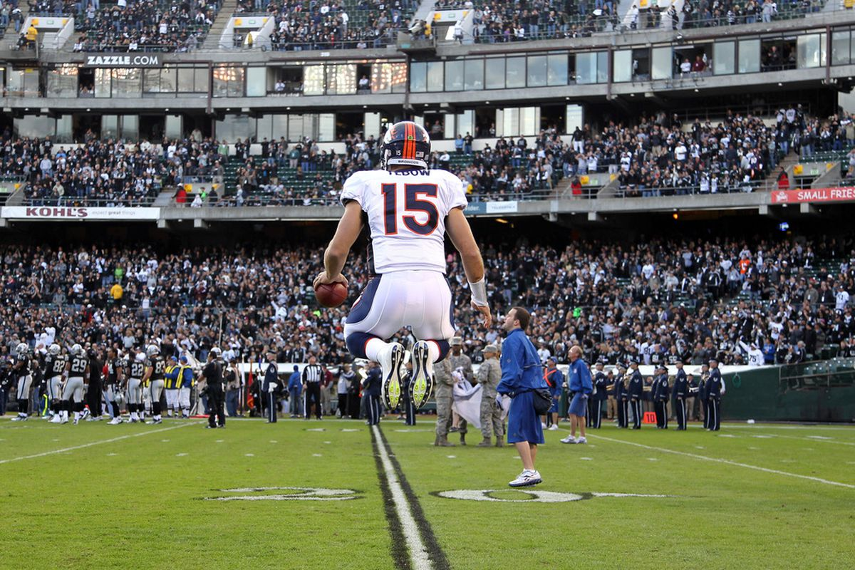 OAKLAND, CA - NOVEMBER 06:  Tim Tebow #15 of the Denver Broncos warms up before their game against the Oakland Raiders at O.co Coliseum on November 6, 2011 in Oakland, California.  (Photo by Ezra Shaw/Getty Images)