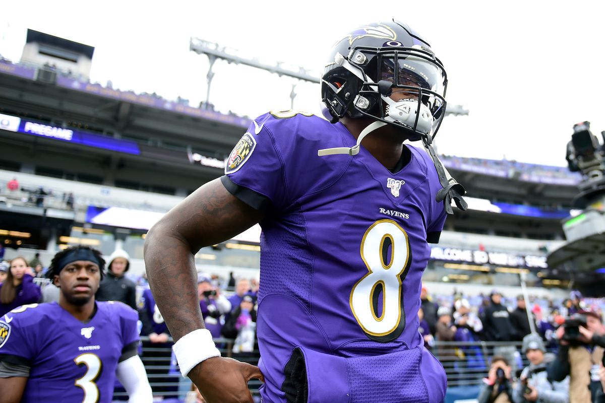 Baltimore Ravens quarterback Lamar Jackson walks onto the field prior to the game against the Houston Texans at M&T Bank Stadium.