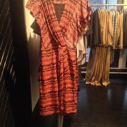 Wrap dress, $243 (was $695)