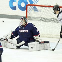 UConn's Rob Nichols (31) sends the puck towards the corner on save.