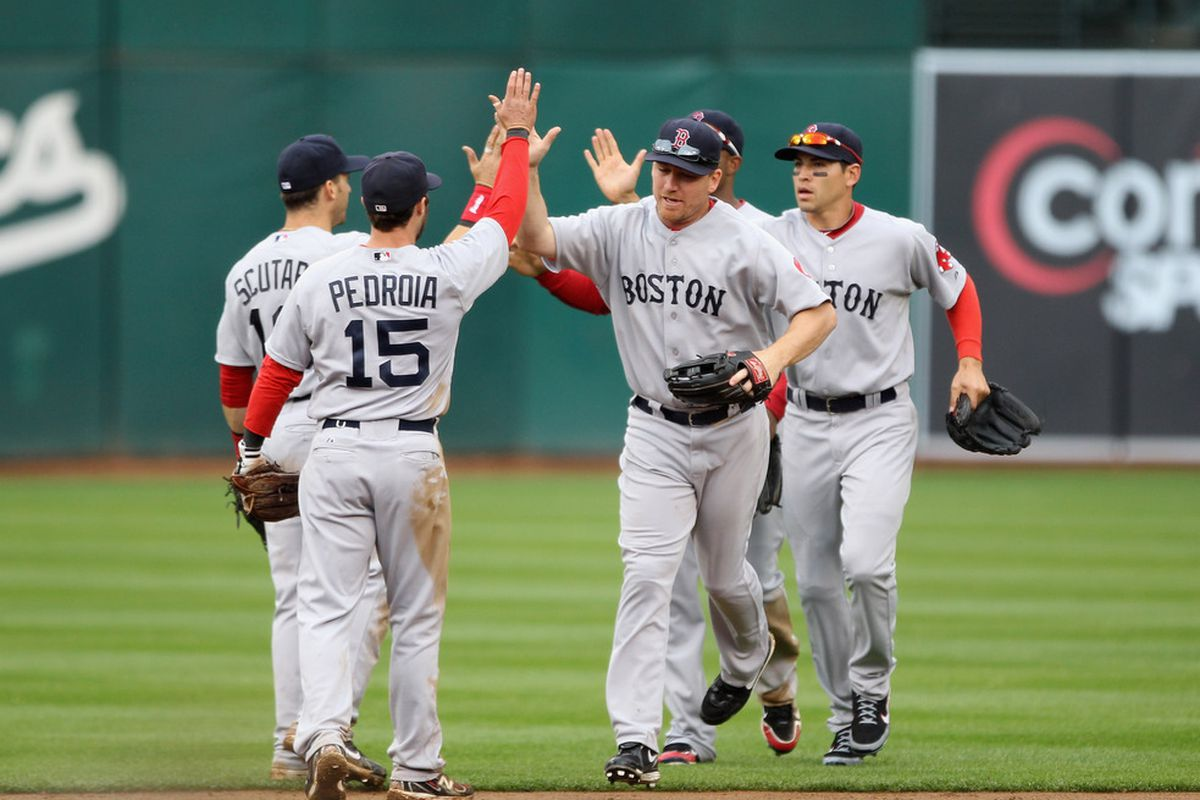 OAKLAND, CA - APRIL 20:  The Boston Red Sox celebrate after they beat the Oakland Athletics at Oakland-Alameda County Coliseum on April 20, 2011 in Oakland, California.  (Photo by Ezra Shaw/Getty Images)
