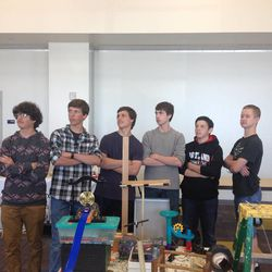 Members of Saint Joseph's Catholic High School's Rube Goldberg team pose in front of their machine.