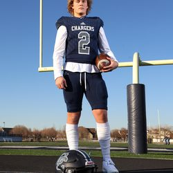 Corner Canyon's Jaxson Dart poses for photos in Draper as he is named 2020 Mr. Football on Wednesday, Dec. 2, 2020.