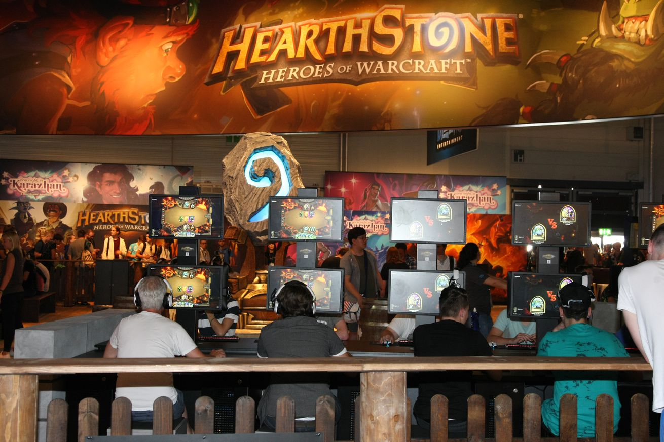 Visitors playing the Game Hearthstone Heroes of Warcraft at...