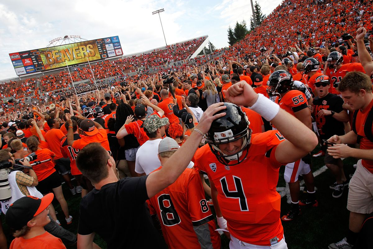 Quarterback Sean Mannion #4 of the Oregon State Beavers celebrates with fans after defeating the Wisconsin Badgers 10-7 on September 8, 2012 at the Reser Stadium in Corvallis, Oregon.