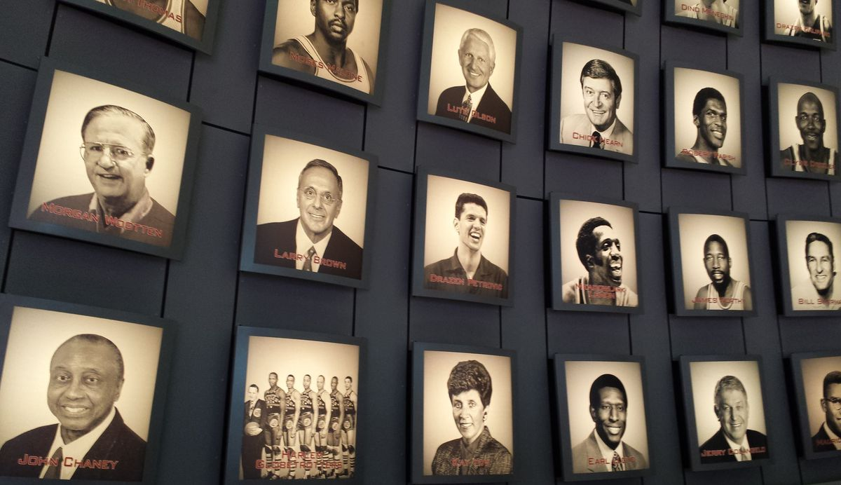 Portraits of many Hall of Famers including Drazen Petrovic in the middle, smiling broadly.